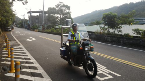 Scooter rider on Taiwanese country road